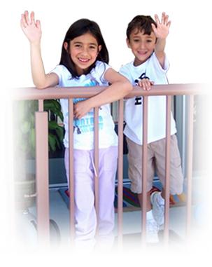 Two children waving hi